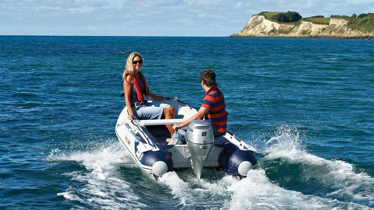 Mother and son riding a Highfield boat powered by a Honda BF8 outboard engine